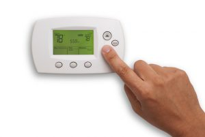 digital-thermostat-male-hand