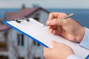 Hand-signing-document-clipboard-home