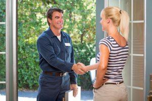 handshake-woman-technician-door