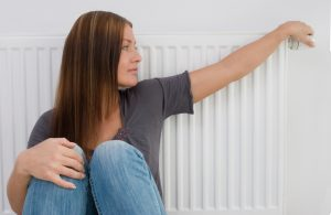 woman-by-heater-boiler-arm