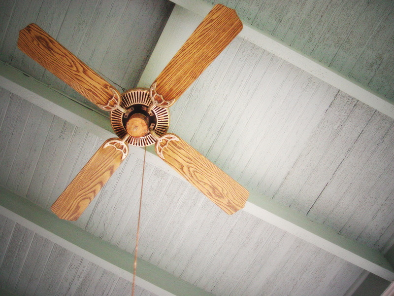 brown-wooden-ceiling-fan-on-grey-ceiling