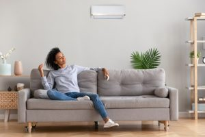 woman-sitting-in-modern-living-room-enjoying-comfort