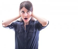 woman-covering-ears-to-avoid-hearing