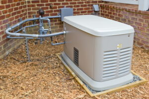 whole-house-generator-installed-next-to-brick-house