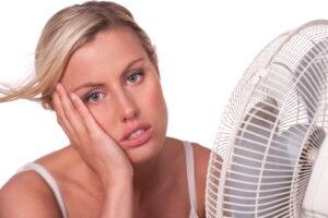 woman-sitting-in-front-of-fan