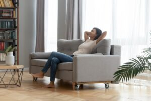 young-woman-looking-comfortable-on-couch