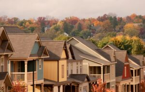 row-of-houses-with-orange-trees-in-background